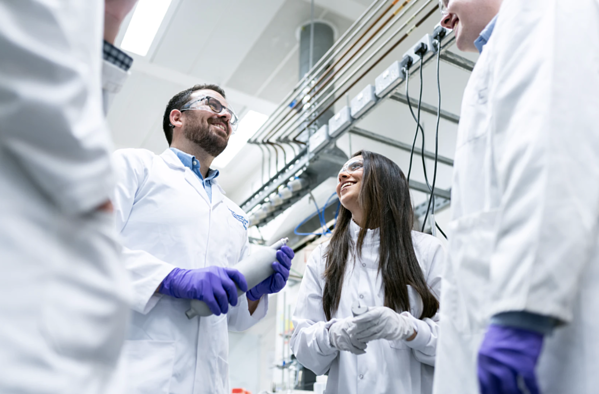 Chemical-engineers-talk-in-laboratory