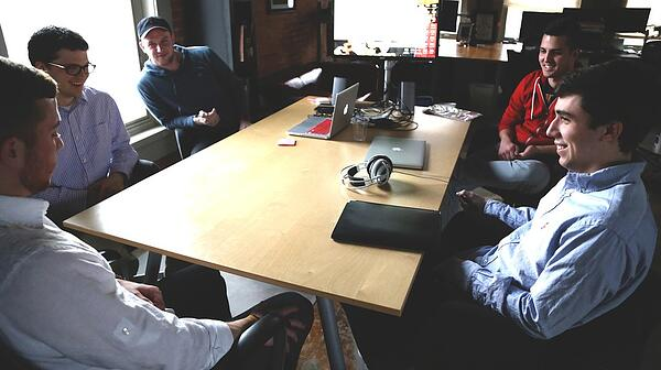 Startup sitting around the table giving feedback