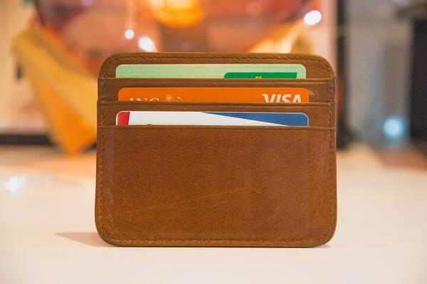 brown wallet with credit cards