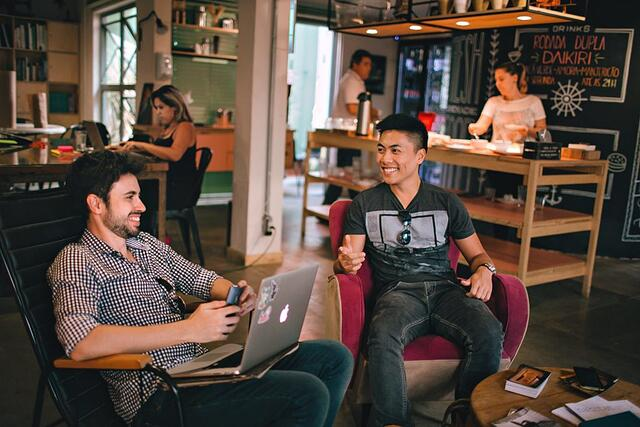 Two techpreneurs working in a shared office space