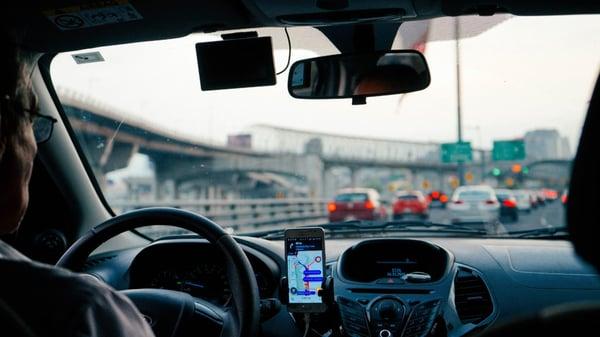 uber driver in car in traffic