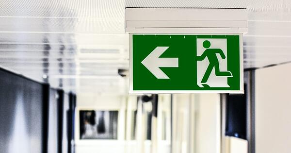 green and white sign emergency exit
