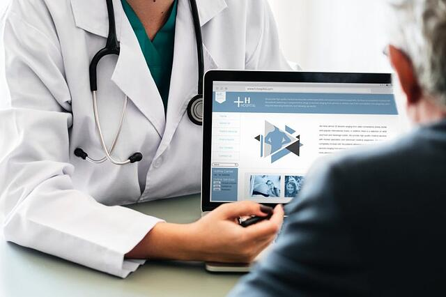 Doctor explaining Medical Technology to Patient