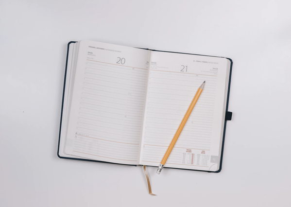 calendar notebook pencil