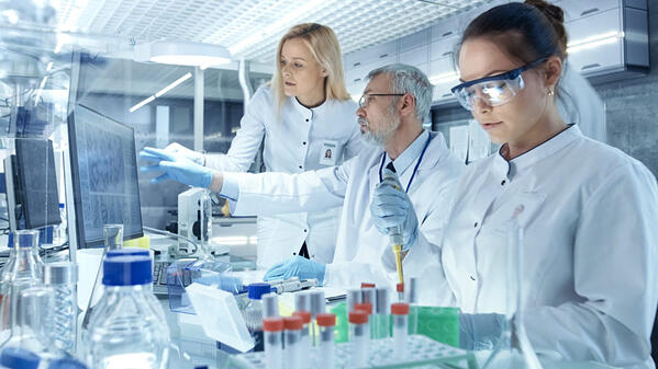 three scientists in wet lab