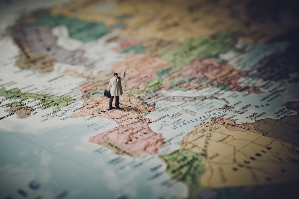 man on world map