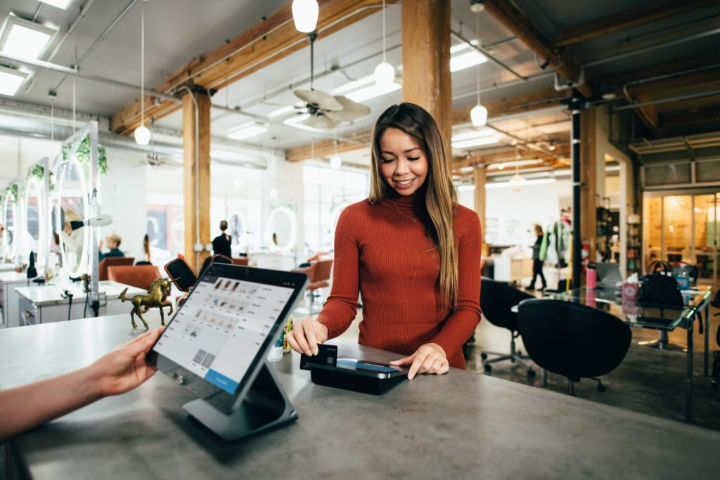 turned-on monitor customers paying credit card